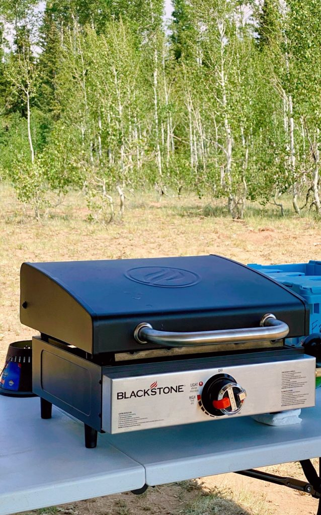 Blackstone Griddle on a table in the woods.