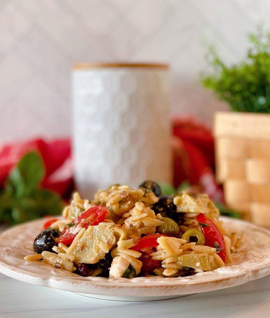 White plate with Muffuletta Olive Pasta Salad.