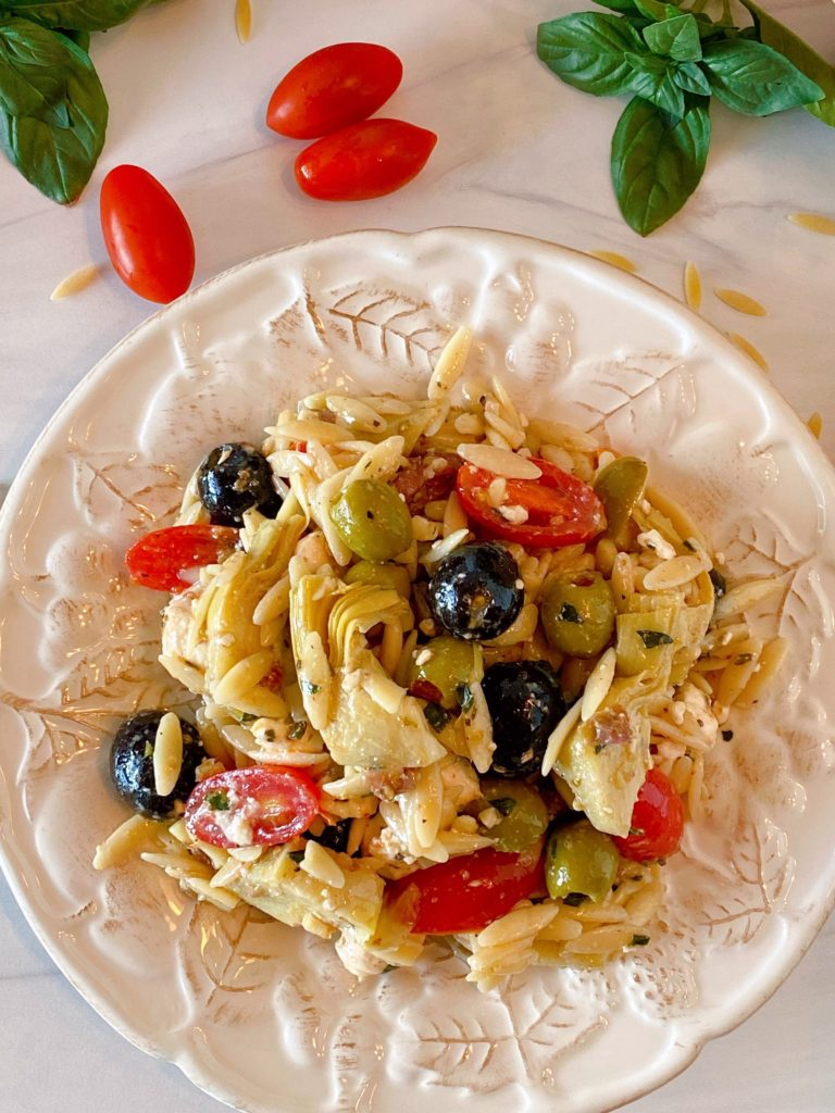 Muffuletta Olive Pasta Salad on a white plate single serving.