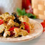 Muffuletta Olive Pasta Salad on a rustic plate.