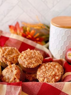 Pumpkin Apple Muffins in a basket on the kitchen counter.