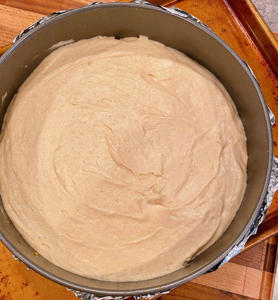 Cake batter over the top of the cranberry topping.