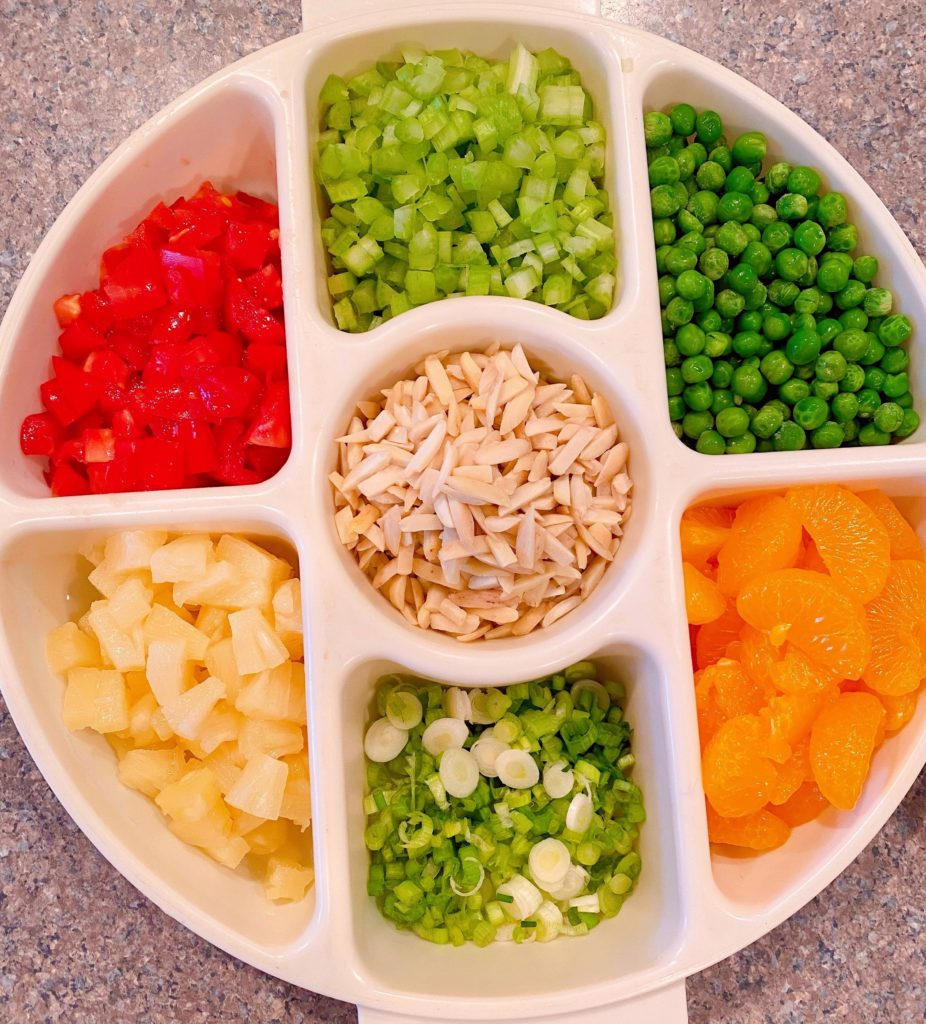 Toppings for Haystacks in a divided container.